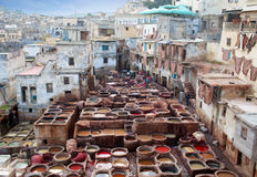 Men working hard in the tannery souk in Fez, Morocco Royalty Free Stock Photos