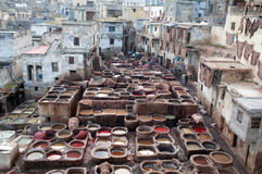 Men working hard in the tannery souk in Fez, Morocco Stock Photos