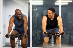 Men working out. Cheerful men working out in gym Royalty Free Stock Images