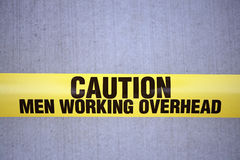 Men working overhead sign Royalty Free Stock Photos