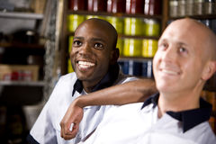 Men working in print shop stock photography