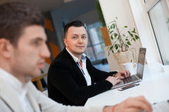 Men working in startup center Royalty Free Stock Images