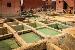 Men working at a tannery. Marrakesh. Morocco Royalty Free Stock Photos