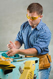 Men works on woodworking mashine Stock Photos