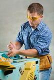 Men works on woodworking mashine Stock Photos