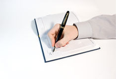 Men write in datebook Royalty Free Stock Image