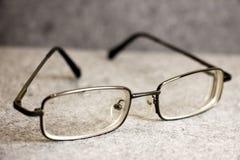 Men& x27; 与一个稀薄的外缘的s玻璃 图库摄影