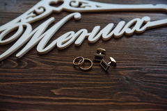 Men's accessories. Bow-tie, cufflinks, gold rings. Groom details Stock Photo