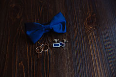 Men's accessories. Bow-tie, cufflinks, gold rings. Groom details Royalty Free Stock Photo