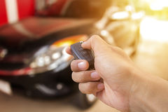 Men's hand presses on the remote control car Stock Photos