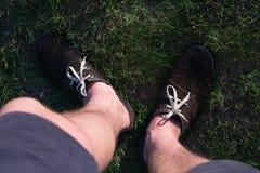 Men& x27;s legs in brown shoes Stock Photo