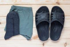 Men& x27; tela pura e pantofole di s Fotografia Stock