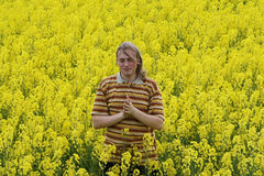 Men in yellow flowers Royalty Free Stock Images