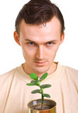 Men with a young plant Stock Image