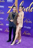 Mena Massoud and Laysla De Oliveira. At the Los Angeles premiere of `Aladdin` held at the El Capitan Theatre in Hollywood, USA on May 21, 2019 royalty free stock image