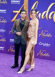 Mena Massoud and Laysla De Oliveira. At the Los Angeles premiere of `Aladdin` held at the El Capitan Theatre in Hollywood, USA on May 21, 2019 royalty free stock photos