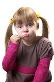 Menace. Funny little girl meaning with fist isolated over white background Stock Image