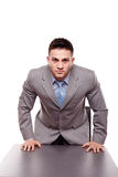 Menacing businessman with hands on the desk Royalty Free Stock Images