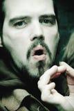 Menacing Guy Smoking Cigar Royalty Free Stock Photo