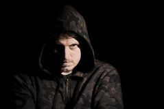 Menacing male. Dark and moody portrait of a menacing male Royalty Free Stock Images