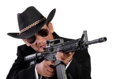 Menacing man gun blazing, isolated on white Royalty Free Stock Image