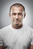 Menacing man portrait. Fine art portrait of a menacing man, studio close up Stock Images