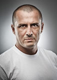 Menacing man portrait. Fine art portrait of a menacing man, studio close up Stock Image