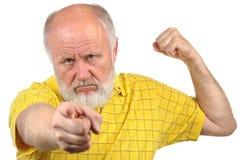 Menacing senior bald man. In yellow shirt Royalty Free Stock Photography