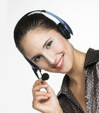 Menager. Young woman speaking by phone Stock Images