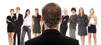 Menager que fala com grupo de empresários Imagens de Stock