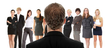 Menager talking with group of businesspeople. Studio shoot stock images