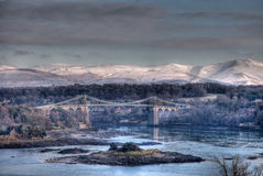 Menai Bridge. In winter with Snow on the snowdonia National Park North Wales Stock Images