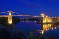 Menai Bridge. Reflections of the town and Suspension bridge Royalty Free Stock Images