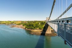 Menai Bridge, Anglesey, Wales, UK. View from Menai Bridge, Anglesey, Gwynedd, Wales, UK - looking towards Coed Cyrnol Stock Photos