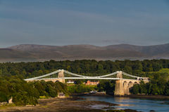 Menai Bridge, connecting Snowdonia and Anglesey. Thomas Telford's Menai Bridge carries a road across the Menai Straits between, Snowdonia and Anglesey. Wales Royalty Free Stock Image