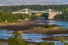 Menai Bridge, connecting Snowdonia and Anglesey. Thomas Telford's Menai Bridge carries a road across the Menai Straits between, Snowdonia and Anglesey. Wales Royalty Free Stock Images