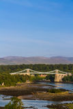 Menai Bridge, connecting Snowdonia and Anglesey. Thomas Telford's Menai Bridge carries a road across the Menai Straits between, Snowdonia and Anglesey. Wales Stock Photography