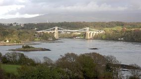 Menai Bridge and the Straits at sunset Isle of Anglesey North Wales. United Kingdom stock video footage