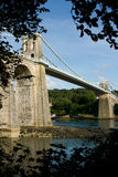 Menai suspension bridge. A view of the historic Menai suspension bridge spanning the Menai Straits, Gwynnedd, Wales, UK Royalty Free Stock Photo