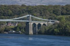 The Menai Suspension Bridge, close-up. The Menai Suspension Bridge is a suspension bridge to carry road traffic between the island of Anglesey and the mainland Stock Photos