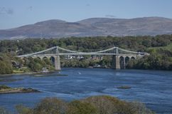The Menai Suspension Bridge, the structure. The Menai Suspension Bridge is a suspension bridge to carry road traffic between the island of Anglesey and the Stock Image