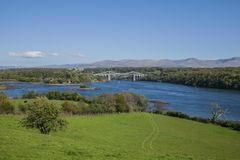 The Menai Suspension Bridge, Wales. The Menai Suspension Bridge is a suspension bridge to carry road traffic between the island of Anglesey and the mainland of Royalty Free Stock Photography