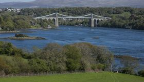 The Menai Suspension Bridge, North Wales. The Menai Suspension Bridge is a suspension bridge to carry road traffic between the island of Anglesey and the Royalty Free Stock Photos