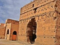 The Menara garens. The ocher pavilion in front of the Atlas Mountains: this panorama of the Menara gardens is one of the most popular motifs on postcards of royalty free stock images