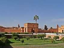The Menara garens. The ocher pavilion in front of the Atlas Mountains: this panorama of the Menara gardens is one of the most popular motifs on postcards of stock image