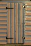 Menchie i błękitny pasiasty plażowy budy drzwi zdjęcie stock
