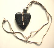 Mended heart. Mended broken heart on a leather strap Stock Photos
