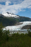 Mendenhall Glacier. In Alaska with mountain and lake Royalty Free Stock Image