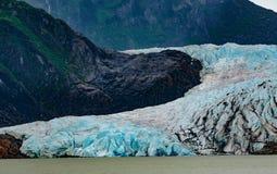 Mendenhall Glacier. Juneau, AK, USA - May 25, 2016:  View of the moraine and blue ice of the Mendenhall Glacier Royalty Free Stock Photo