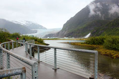 Mendenhall Glacier, Juneau Alaska. Mendenhall Glacier walkway, Juneau Alaska.  At the center can be seen the Glacier and to the Right the waterfall Stock Photography